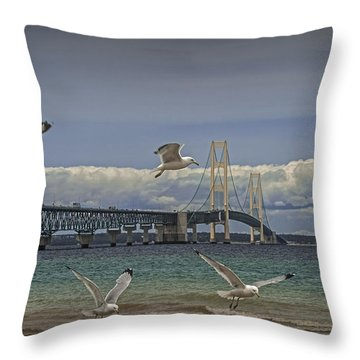 Gulls Flying By The Bridge At The Straits Of Mackinac Throw Pillow