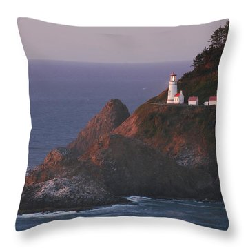 Haceta Head Lighthouse At Sunset Throw Pillow