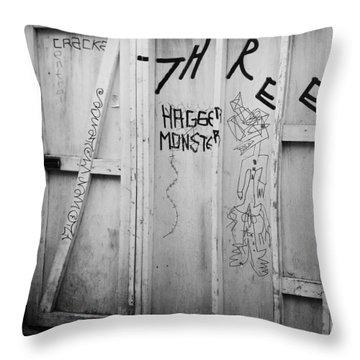 Hagger Monster Throw Pillow by Anna Villarreal Garbis