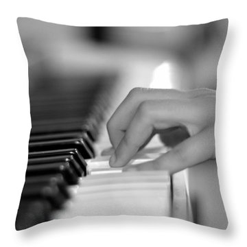 Hand On Piano Keyboard Throw Pillow