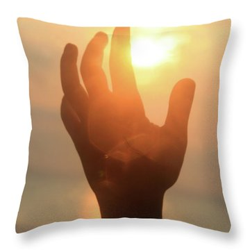 Hand Reaching Fore The Sun Throw Pillow