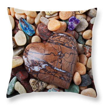 Heart Stone Among River Stones Throw Pillow by Garry Gay