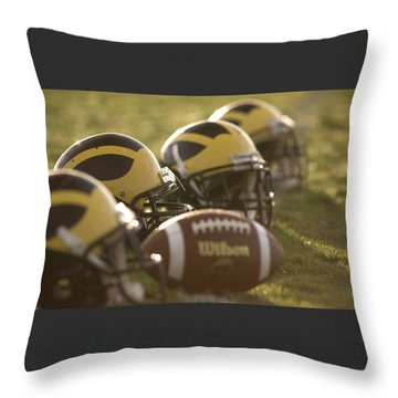 Throw Pillow featuring the photograph Helmets And A Football On The Field At Dawn by Michigan Helmet