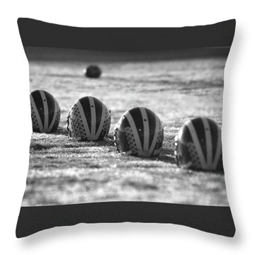 Helmets On Dew-covered Field At Dawn Black And White Throw Pillow