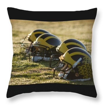 Throw Pillow featuring the photograph Helmets On The Field At Dawn by Michigan Helmet