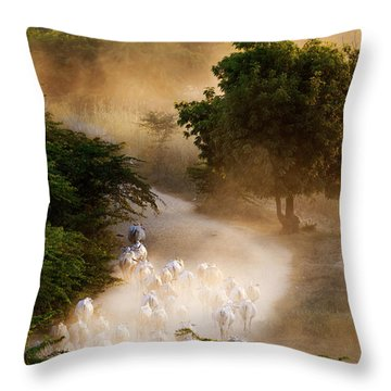 Throw Pillow featuring the photograph herd and farmer going home in the evening, Bagan Myanmar by Pradeep Raja Prints