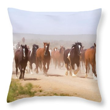 Herd Of Horses During The Great American Horse Drive On A Dusty Road Throw Pillow