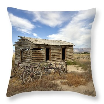 Historic Cabin And Buckboard Wheels In Big Horn County In Wyoming Throw Pillow