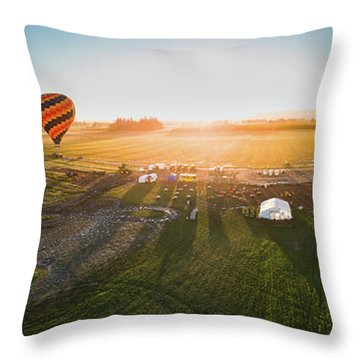 Throw Pillow featuring the photograph Hot Air Balloon Taking Off At Sunrise by William Lee