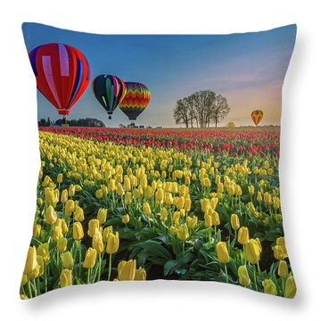 Hot Air Balloons Over Tulip Fields Throw Pillow by William Lee
