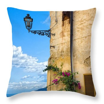 House With Bougainvillea Street Lamp And Distant Sea Throw Pillow