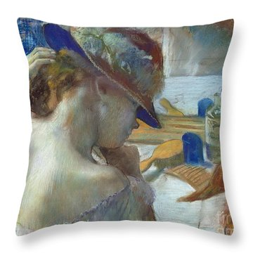 In Front Of The Mirror Throw Pillow by Edgar Degas