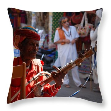 Indian Street Musician Throw Pillow by Sabine Meisel