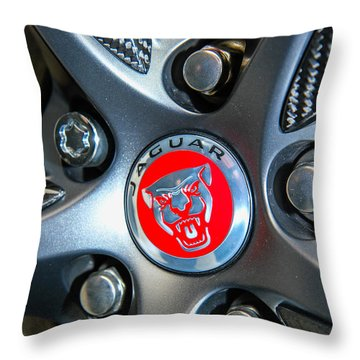 Jaguar Hubcap Throw Pillow by Robert Hebert