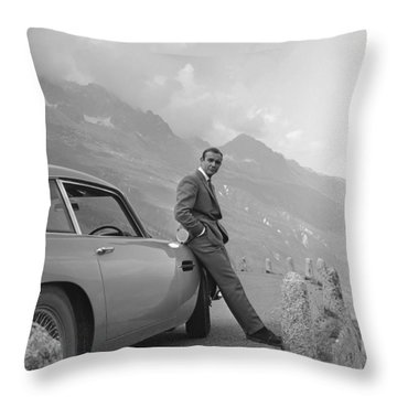 James Bond And His Aston Martin Throw Pillow