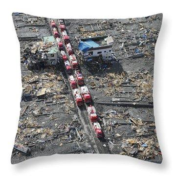 Japanese Fire Trucks Line A Road Throw Pillow by Stocktrek Images