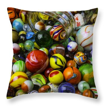 Jar Pouring Out Glass Marbles Throw Pillow