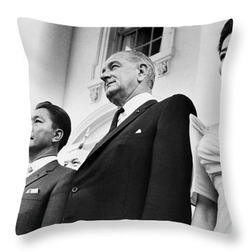 Johnson And Marcos, 1966 Throw Pillow by Granger