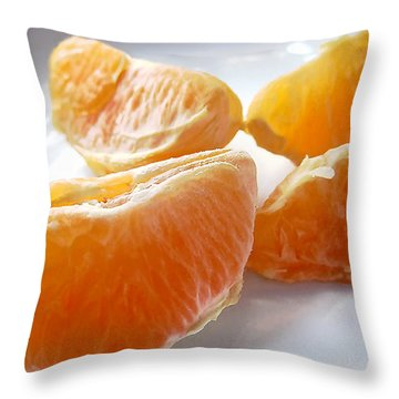 Throw Pillow featuring the photograph Juicy Orange Slices On A Blue Glass Plate by Louise Kumpf