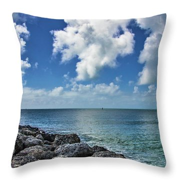 Throw Pillow featuring the photograph Key West Clouds On The Rocks by Bob Slitzan