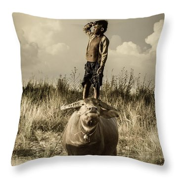 Throw Pillow featuring the photograph Kid And Cow by Arik S Mintorogo