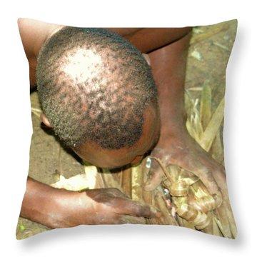 Lamu Island - Man Breathe Life Into A Fire 1 Throw Pillow