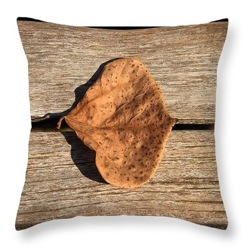 Leaf On Wooden Plank Throw Pillow