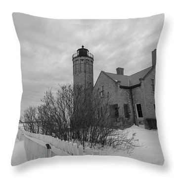 Throw Pillow featuring the photograph Lighthouse And Mackinac Bridge Winter Black And White  by John McGraw
