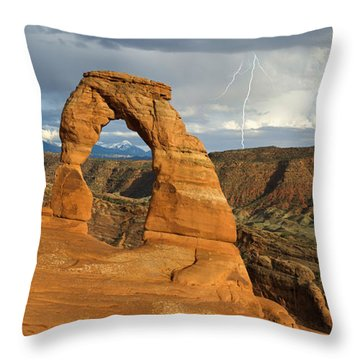 Throw Pillow featuring the photograph Lightning At Delicate Arch by Aaron Spong