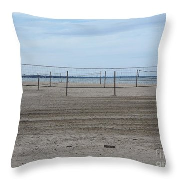 Lonely Beach Volleyball Throw Pillow