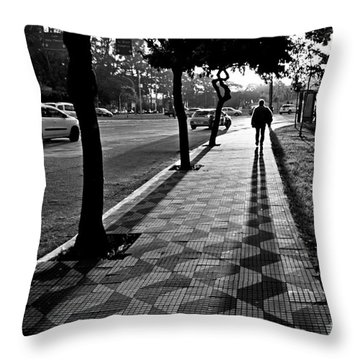 Lonely Man Walking At Dusk In Sao Paulo Throw Pillow