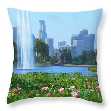 Throw Pillow featuring the photograph Lotus Blooms In Echo Park And Los Angeles Skyline by Ram Vasudev