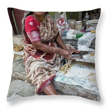 Making Chapatti Throw Pillow by Marion Galt