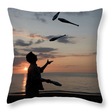 Man Juggling With Four Clubs At Sunset Throw Pillow