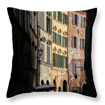 Man Walking Alone In Small Street In Siena, Tuscany, Italy Throw Pillow