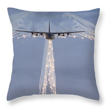 Throw Pillow featuring the photograph Mc-130h Combat Talon Dropping Flares by Gert Kromhout