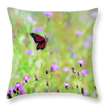 Throw Pillow featuring the photograph Monarch Butterfly In Flight Over The Wildflowers by Kerri Farley