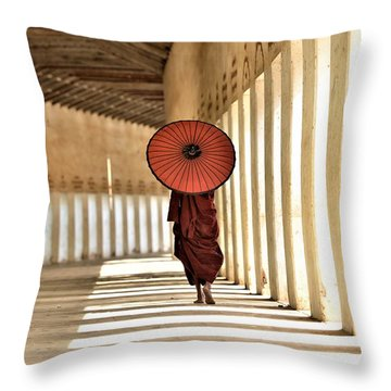 Monk With Umbrella Walking In Th Light Passway Throw Pillow