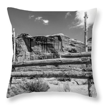 Throw Pillow featuring the photograph Fence In Monument Valley - Bw by Dany Lison
