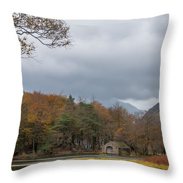 Moody Clouds Over A Boathouse On Wast Water In The Lake District Throw Pillow