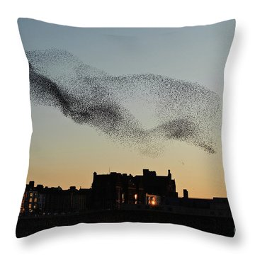 Murmuration Of Starlings Over Aberystwyth Wales Uk Throw Pillow