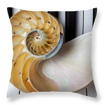 Nautilus Shell On Piano Keys Throw Pillow by Garry Gay