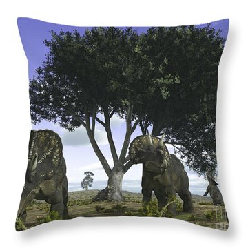 Nedoceratops Graze Beneath A Giant Oak Throw Pillow by Walter Myers