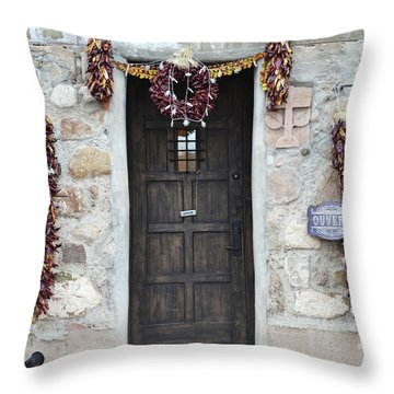 Throw Pillow featuring the photograph New Mexico Red Chili Ristras Door by Andrea Hazel Ihlefeld