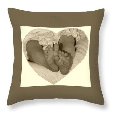 Newborn Feet Throw Pillow by Ellen O'Reilly