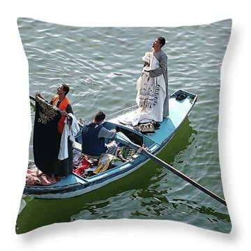 Throw Pillow featuring the digital art Nile River Garment Vendors - Egypt by Joseph Hendrix