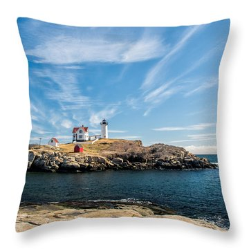 Nubble Lighthouse With Dramatic Clouds Throw Pillow by Nancy De Flon