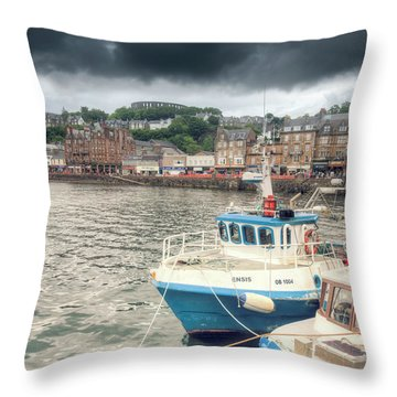 Oban Harbour Under A Dark Sky Throw Pillow by Ray Devlin