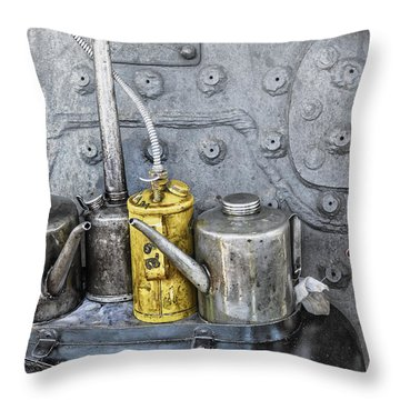 Oil Cans Throw Pillow