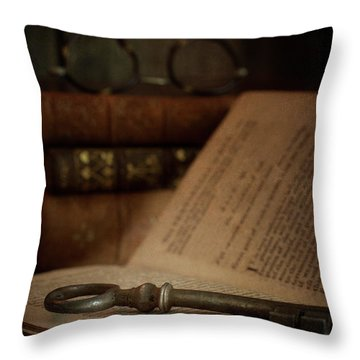Old Book With Key Throw Pillow